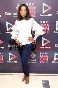 Layole Oyatogun paired her plain bluejeans with a more dramatic blouse and it works. Totally!