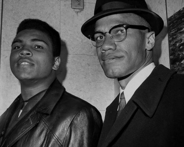 UNITED STATES - MARCH 02:  Cassius Marcellus Clay (Muhammad Ali) with Black Muslim leader Malcolm X at 125th St. and Seventh Ave.  (Photo by John Peodincuk/NY Daily News Archive via Getty Images)