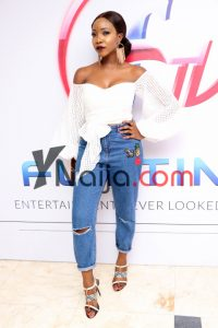 Inidima Okojie gets it all the time. Her mom jeans is perfect with the embroidery applique and cut out knee design.